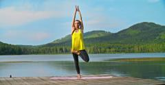 Tree Pose by a Lake Stock Footage