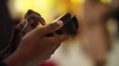 4k Close up on hands of young woman texting in busy public area Stock Footage