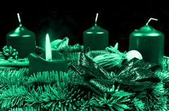 Stock Illustration of Green Advent wreath with burning candle on black background