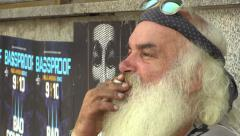 Authentic face homeless man smokes a cigarette Stock Footage
