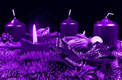 Stock Illustration of Purple Advent wreath with burning candle on black background
