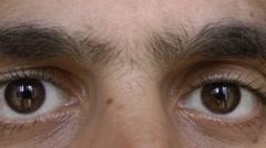 Human eyes look at the camera. Stock Footage