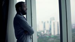 Young businessman admire view from window - stock footage
