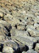 Background. Huge stones of uneven shapes,  lit by sunlight sun Stock Photos