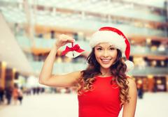 Smiling woman in santa helper hat and jingle bells Stock Photos