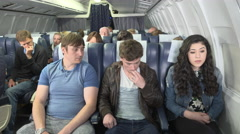 Nervous male passenger not getting sympathy from his fellow passenger - stock footage