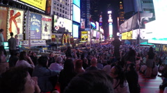 Crowded bleacher seats and Times Square at night in NYC - stock footage