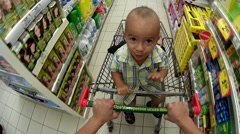 Shopping with a child in the cart . - stock footage
