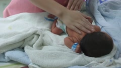 Newborn baby having a massage by the nurse after taking a bath in the hospital Stock Footage