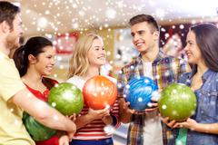 Stock Photo of happy friends in bowling club at winter season
