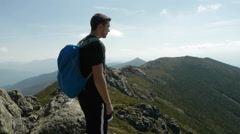 Young Male Backpacker Looking at Mountains Stock Footage