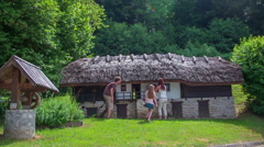 Family is looking historical house Stock Footage