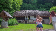 Family is looking old countryside house Stock Footage