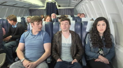 Fear of flying - male passenger angry with friend for being scared of flying Stock Footage
