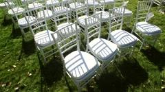 Wedding aisle decor. White wedding chairs. Outdoor Stock Footage