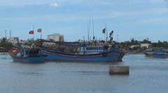 Blue Vietnamese ships moored on the river. red flags are developed in the wind. - stock footage