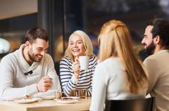 happy couple meeting and drinking tea or coffee - stock photo