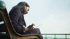 4K Attractive young woman using computer tablet at the seaside Stock Footage