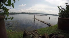 Rod fisherman onboard bamboo raft - stock footage