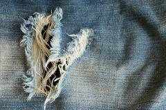 Stock Photo of denim jeans with old torn of fashion jeans design