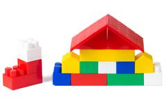 colorful plastic building blocks house on white 3 - stock photo