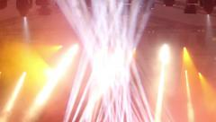 Concert lights - Flashing spotlights collect light in the bunch - stock footage