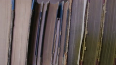 Close up of books stacked horizontally Stock Footage