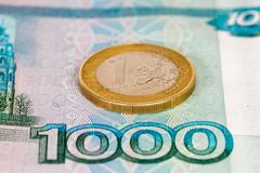 One thousand roubles banknote with one euro Stock Photos
