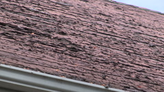 Stock Video Footage of Roof with worn and damaged shingles