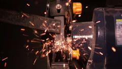 Grinding a piece of metal close up in workshop Stock Footage