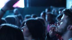 People smoke in the crowd at a concert harming others Stock Footage