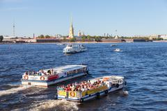 River cruise boats on the Neva  river in summer sunny day Stock Photos