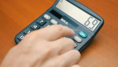 Counting on calculator - stock footage
