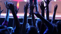 Concert hands A crowd of people jumping with their hands rised near the stage - stock footage