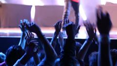 Concert hands A crowd of people jumping with their hands rised near the stage Stock Footage