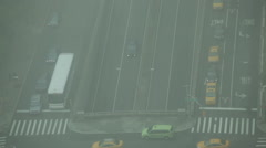 Fast motion traffic during smoggy day on the crossroad in Midtown Manhattan, NYC Stock Footage