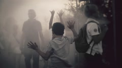 Children playing in a foggy day Stock Footage