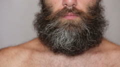 White Man Taking Care of his Lush Beard and Mustache Stock Footage