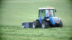 Tractor is cutting the grass on lawn Stock Footage