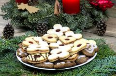 Christmas cookies with Advent wreath on the wooden table Stock Photos
