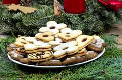 Christmas cookies with Advent wreath on the wooden table - stock photo