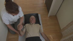 Young nurse, medic woman helping senior people for therapy, physical therapy - stock footage
