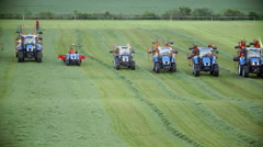 Few tractor is working on nice green grass Stock Footage
