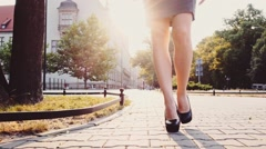 Business woman in black heel shoes walking in the street. Steadicam Slow Motion Stock Footage