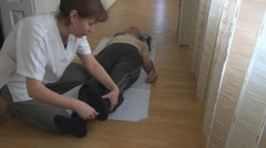 Reflex test, touch and tickle senior man sole, medical testing, physical therapy - stock footage