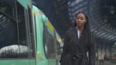 4K Beautiful young professional woman boarding a train at city railway station Stock Footage