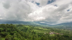 Time Lapse of clouds over Merbabu and Merapi volcanoes, Java, Indonesia Stock Footage