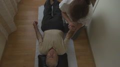 Elderly man at therapy, white nurse female doctor assistance, treatment motion - stock footage