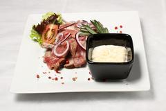 Nearly fresh sliced meat with horseradish - stock photo