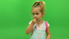 Little girl eat candy Stock Footage